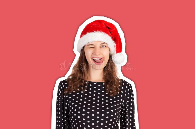 Young beautiful crazy woman in dress portrait. emotional girl in santa claus christmas hat Magazine collage style with trendy stock photos