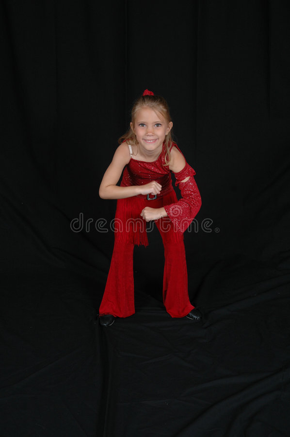 Young Beautiful Dancer. Girl dance performer in red. Beautiful young blonde model royalty free stock photo