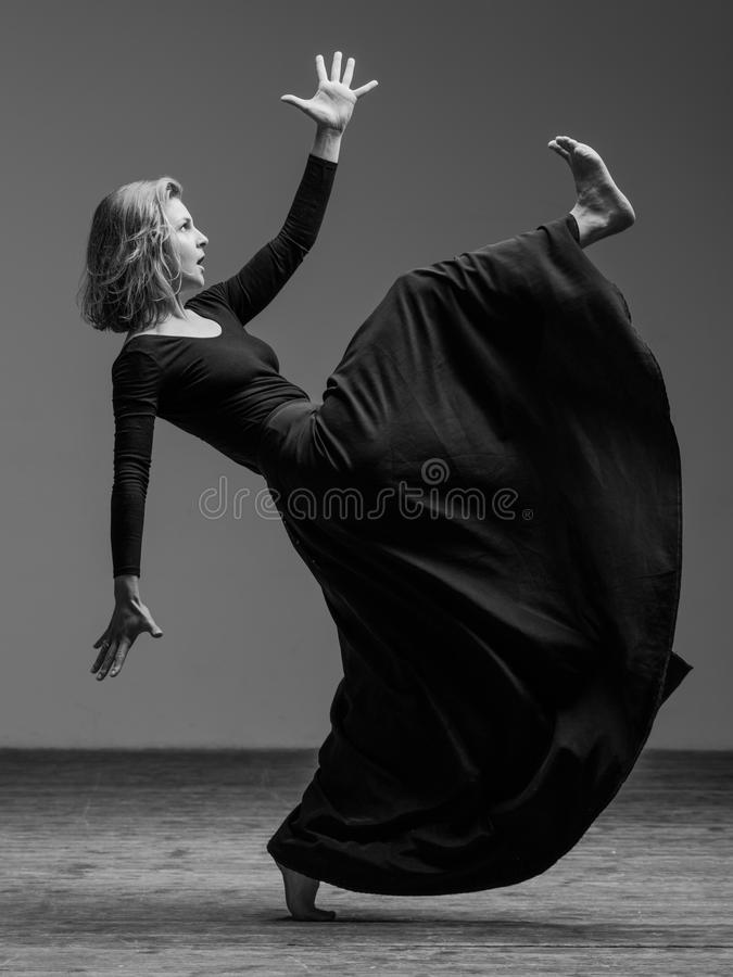 Young beautiful dancer is posing in studio stock photos