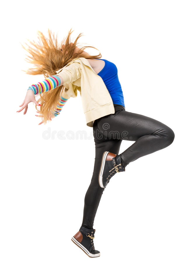 Young beautiful dancer posing on a studio background stock image