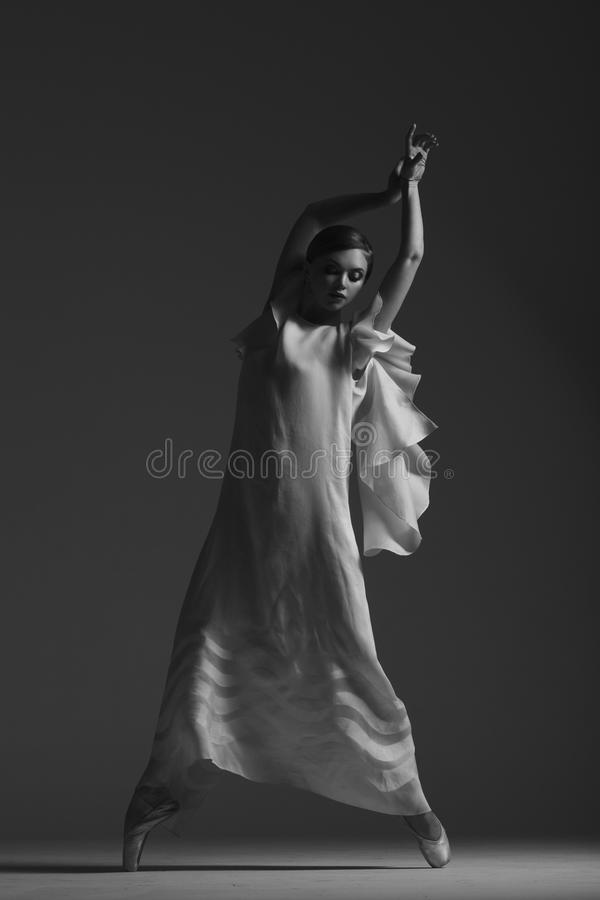 Young beautiful dancer is posing in studio royalty free stock images