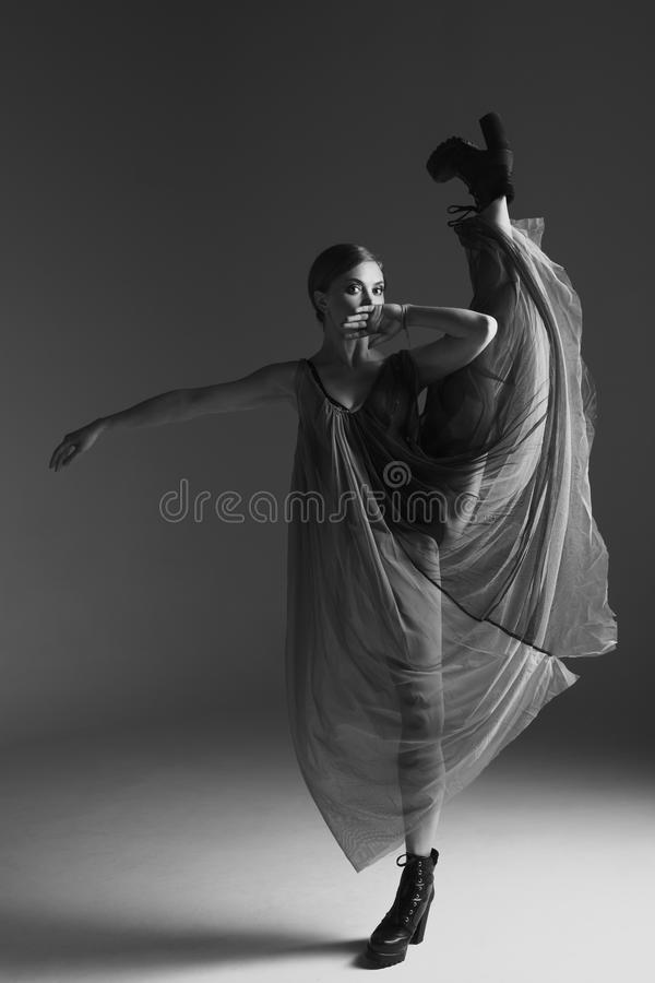 Young beautiful dancer is posing in studio royalty free stock photos