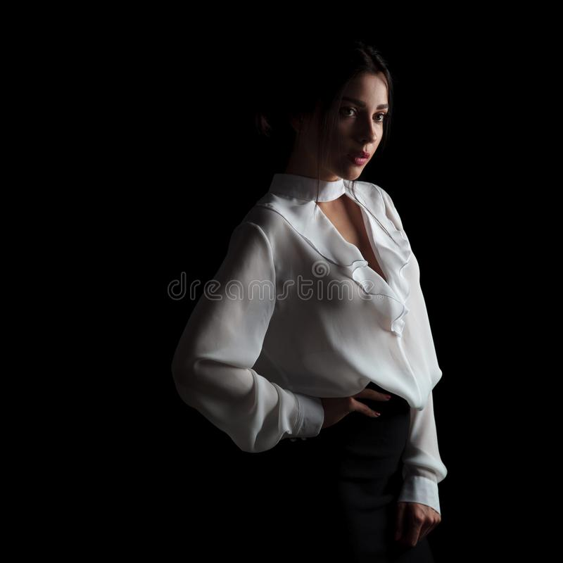 Young beautiful elegant woman standing with hand on waist royalty free stock photos