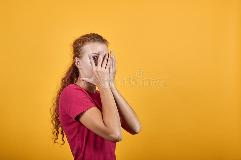 Young beautiful European woman covering her eyes with her hands. royalty free stock images