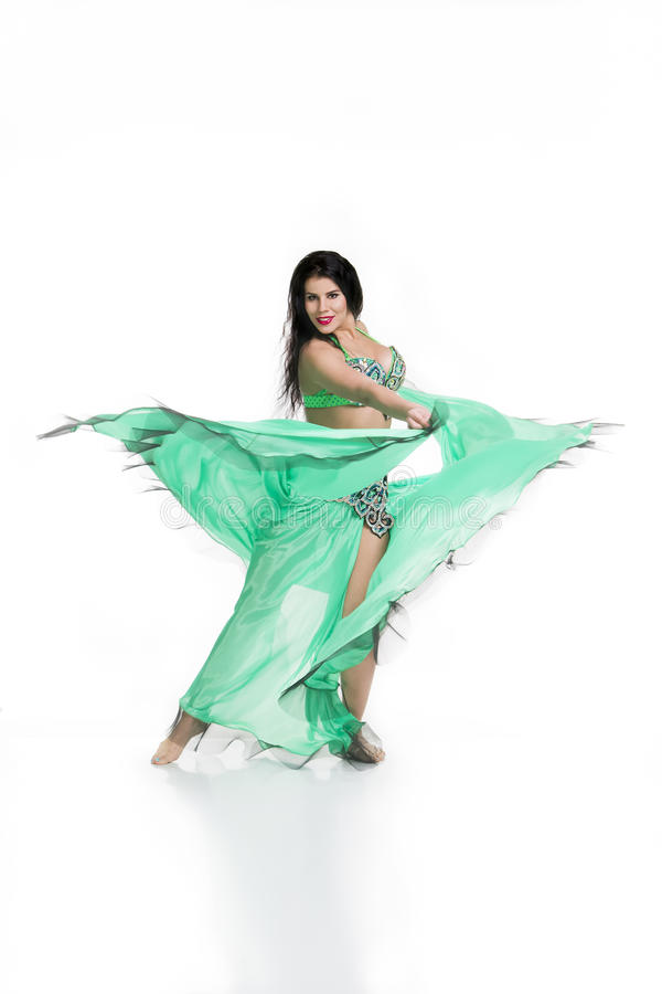 Young beautiful exotic eastern women performs belly dance in ethnic green dress. Isolated on white background stock photos