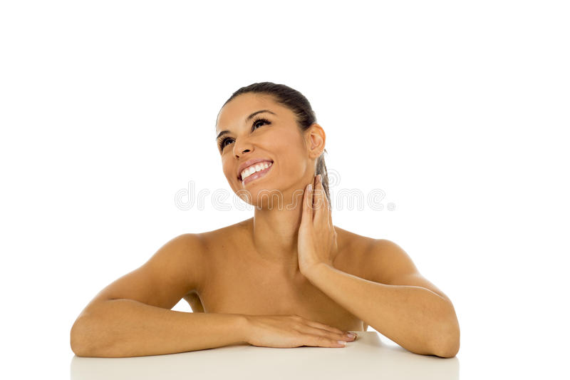 Young beautiful and exotic hispanic woman smiling happy and relaxed isolated on white stock photos