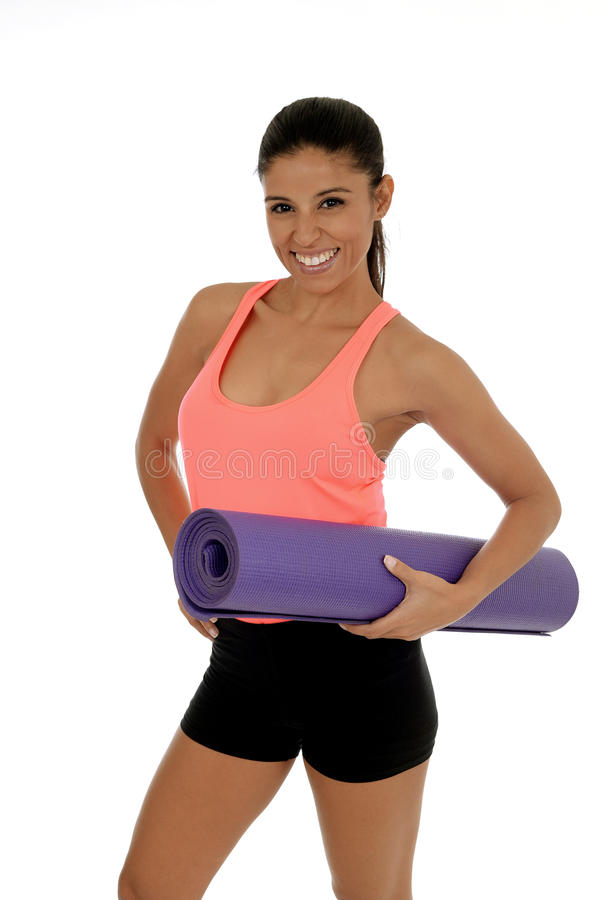 young beautiful and exotic hispanic woman in sport clothes holding yoga mat stock photos