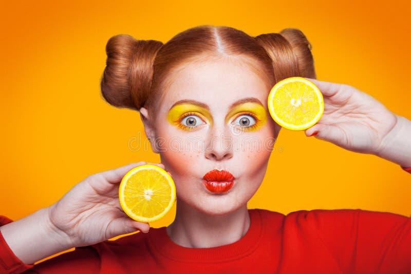 Young beautiful fashion model with Lemon. studio shot. stock image