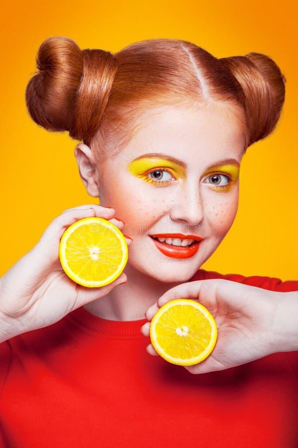 Young beautiful fashion model with Lemon. studio shot. royalty free stock photos