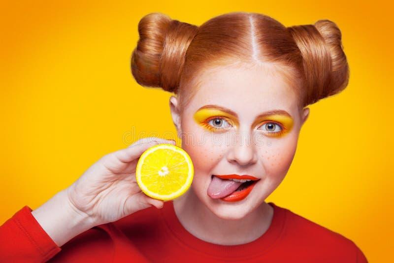 Young beautiful fashion model with Lemon. studio shot. royalty free stock images