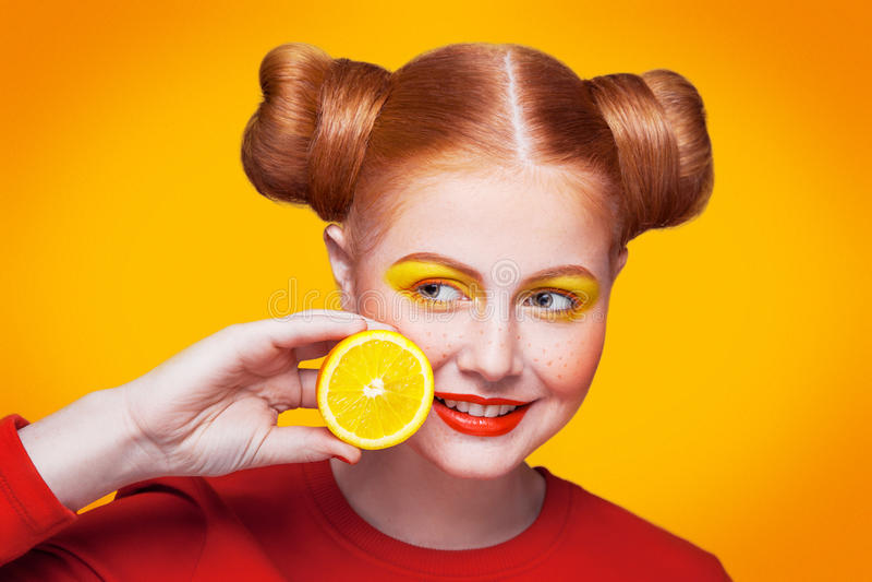 Young beautiful fashion model with Lemon. studio shot. royalty free stock photography