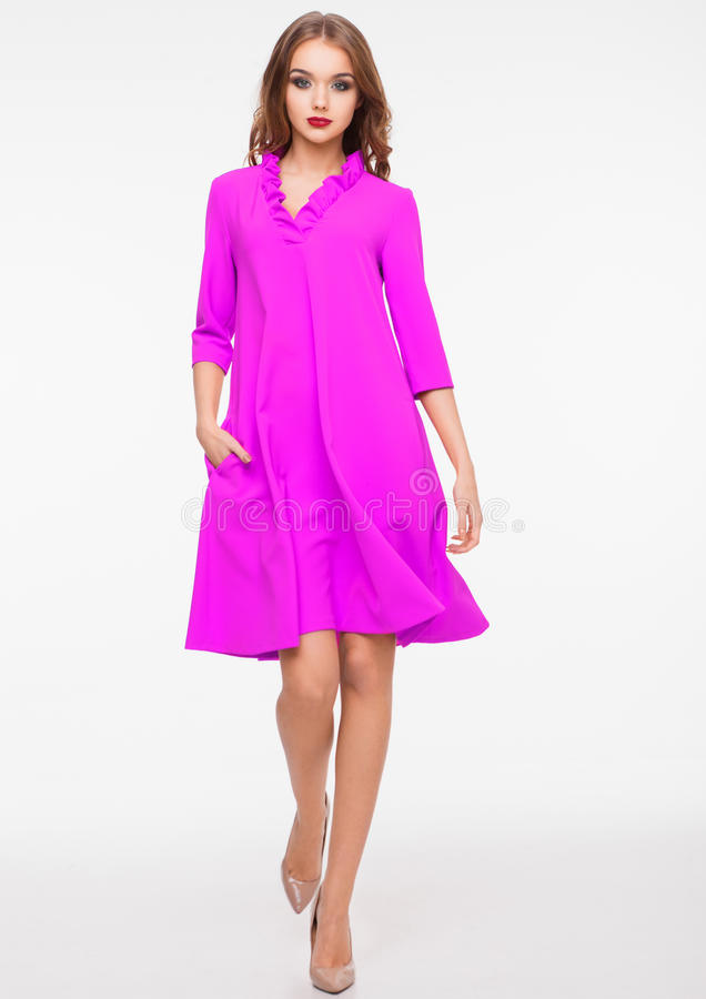 Young beautiful fashion model wearing purple dress royalty free stock images