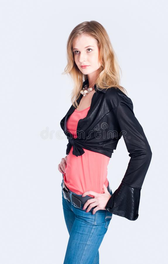 Fashionable woman. Young beautiful fashionable model at white background royalty free stock image