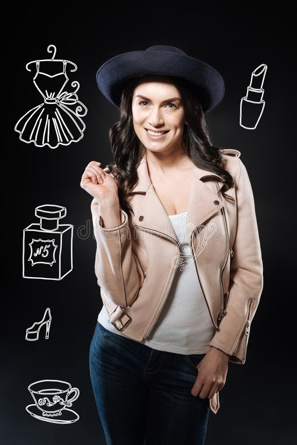 Young beautiful fashionable woman smiling while going shopping stock photos