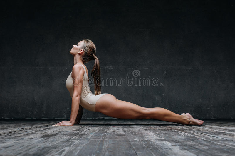 Young beautiful fitness female posing in studio royalty free stock photos