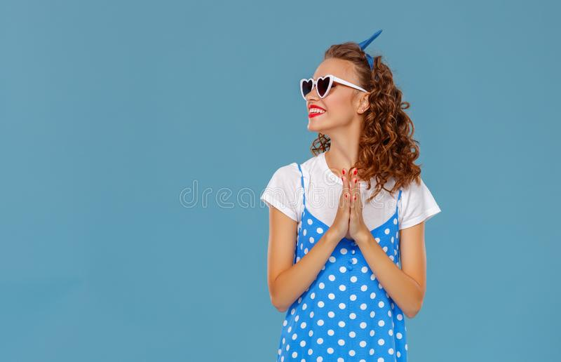 Beautiful funny girl on colored blue background royalty free stock image