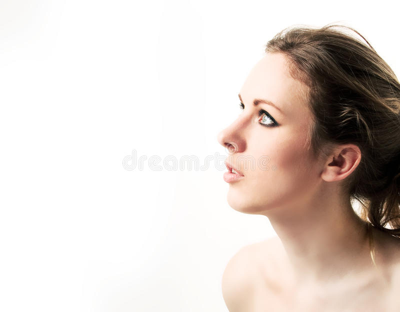Young beautiful girl,. Portrait in a profile stock photography