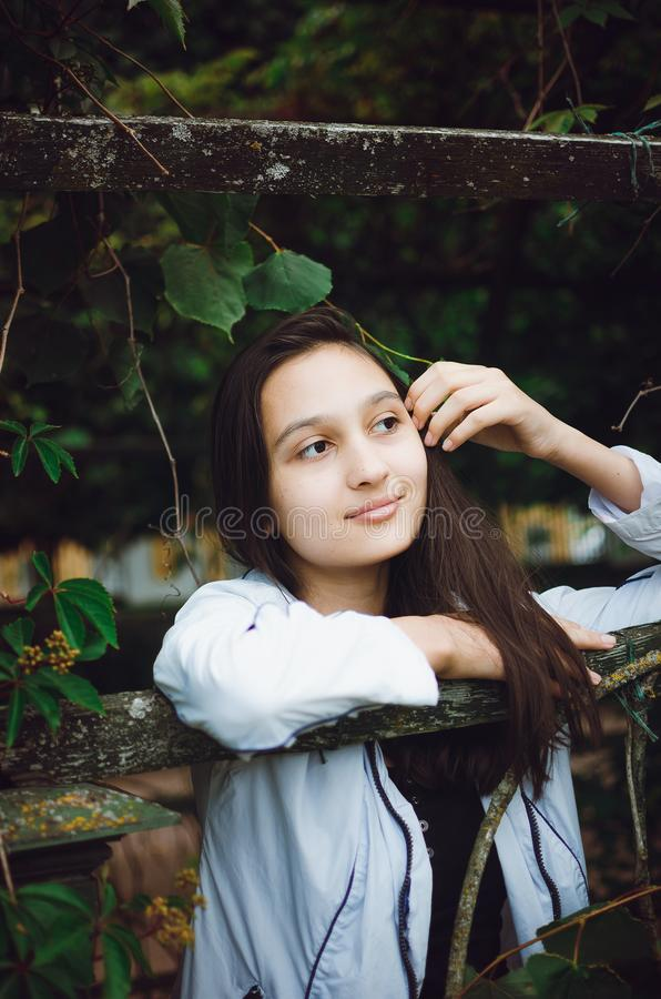 Young beautiful girl on the background of nature. Vertical photo royalty free stock photography