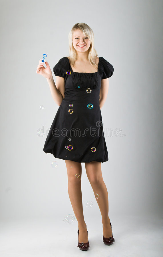 Download Young Beautiful Girl Blow Out Soap Bubbles Stock Image - Image: 9112703