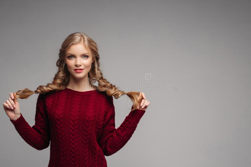 c9f98f61f3d87 Young beautiful girl in bordo clothes posing at camera. royalty free stock  photo
