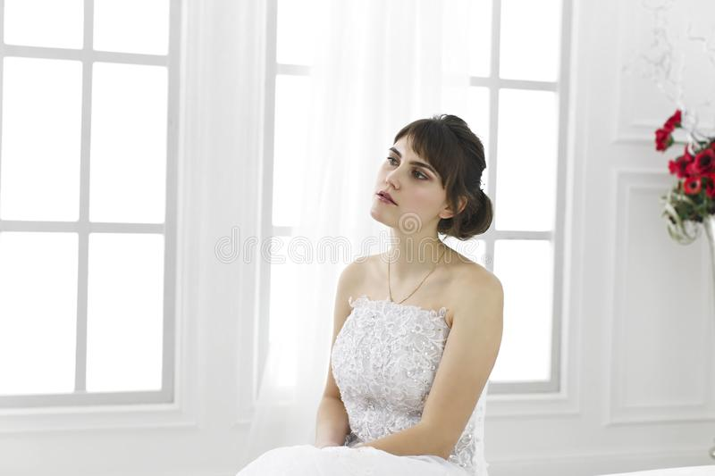 Young beautiful girl in a bride`s dress stock images