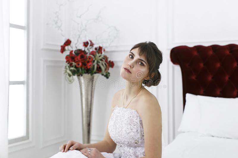 Young beautiful girl in a bride`s dress stock photography