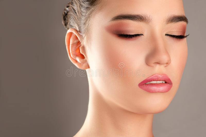 Young beautiful girl with bright makeup on face stock image