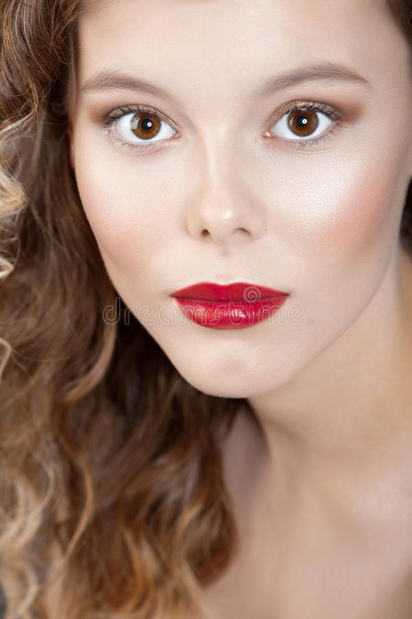 Young beautiful girl with clean perfect skin with red lipstick royalty free stock photo