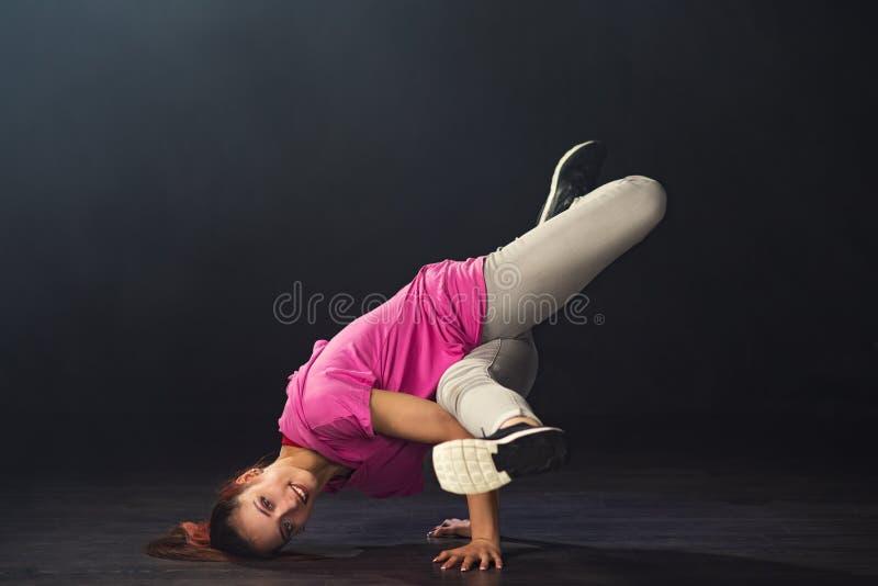Young beautiful girl dancer dancing hip-hop stock photos