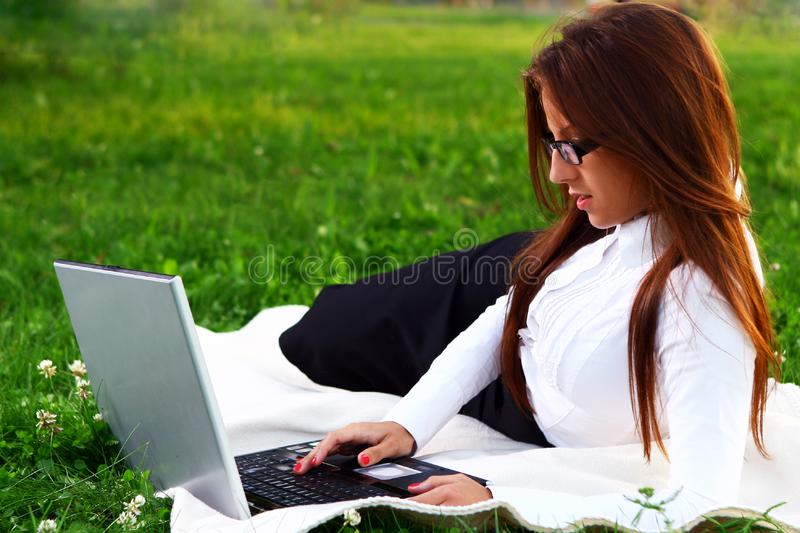 Young and beautiful girl doing home work stock photos