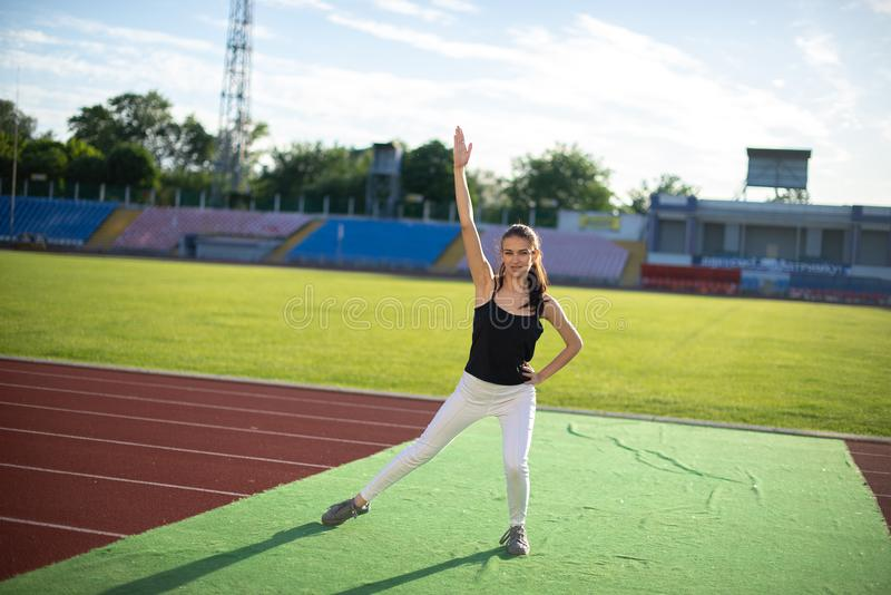 Young beautiful girl doing yoga outdoors in the park.  stock images