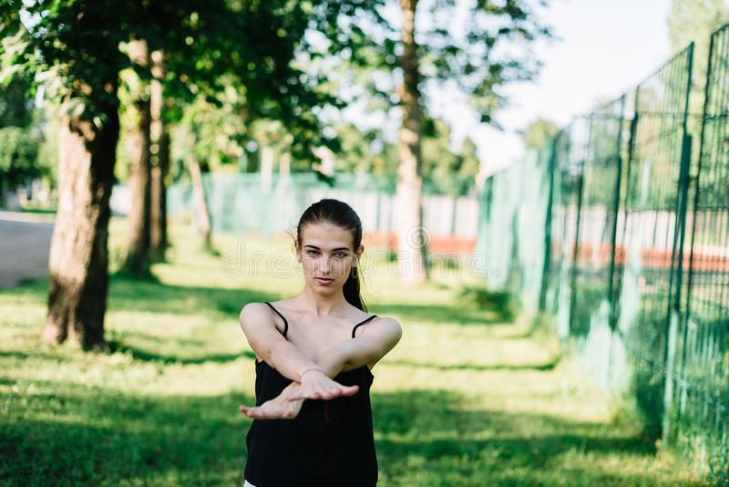 Young beautiful girl doing yoga outdoors in the park.  royalty free stock photography