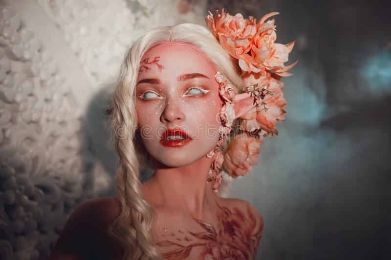 Young beautiful girl elf. Creative make-up and bodyart royalty free stock images