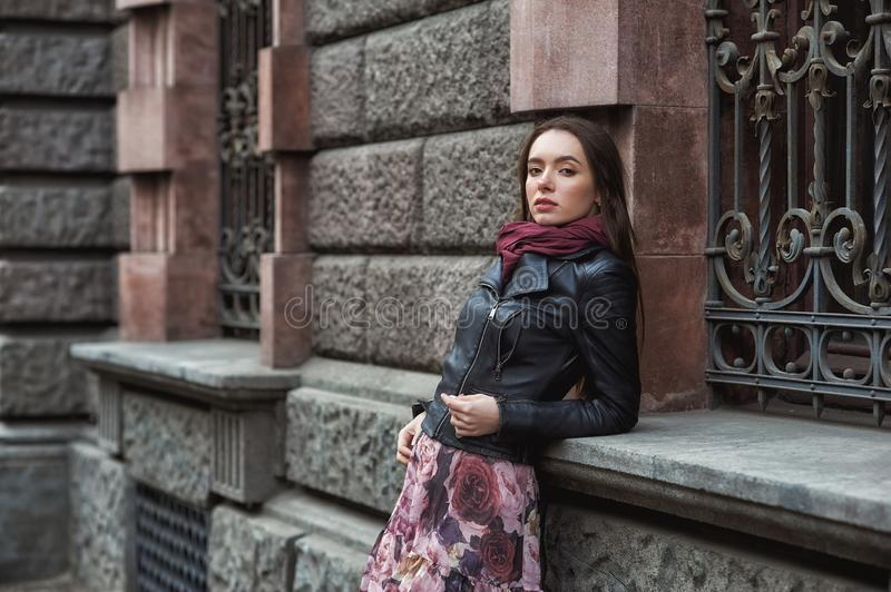 Young beautiful girl in fashionable leather jacket in the city stock images