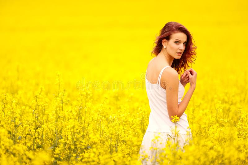 Young beautiful girl in the field stock photos
