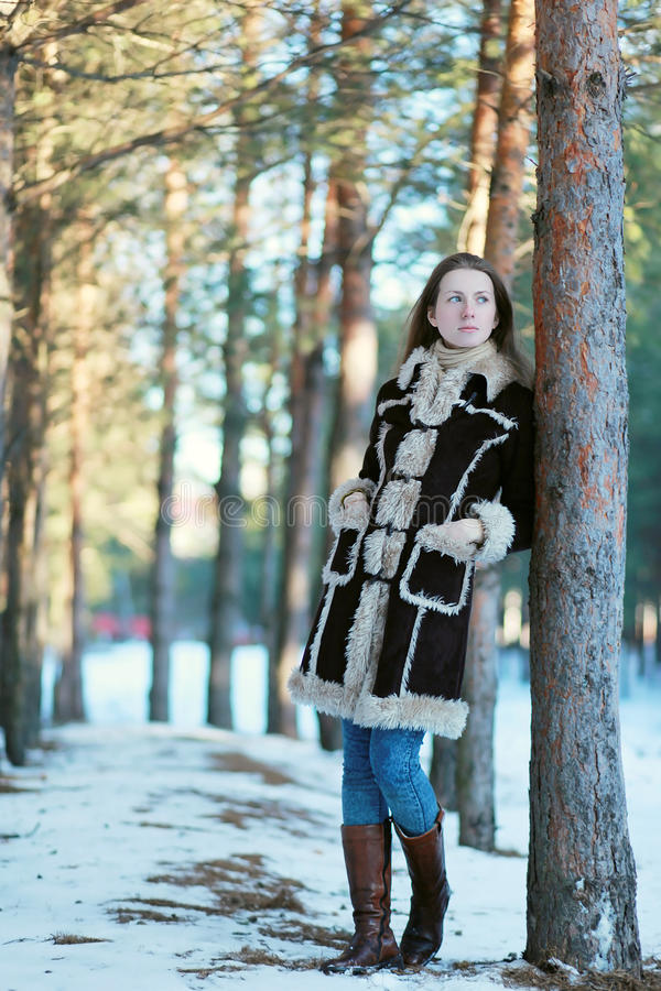 Young beautiful girl in the forest royalty free stock photos