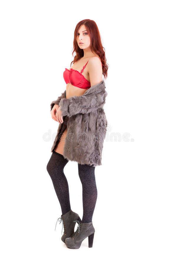 The young beautiful girl in a fur coat stock photos