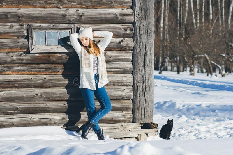 Girl in hat and mittens in winter stock images