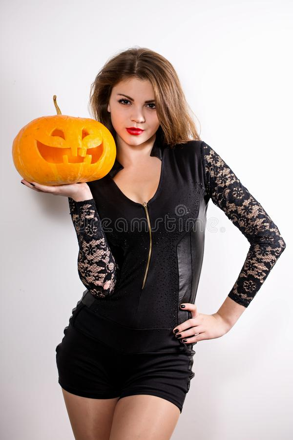 Girl with pumpkin lantern royalty free stock image