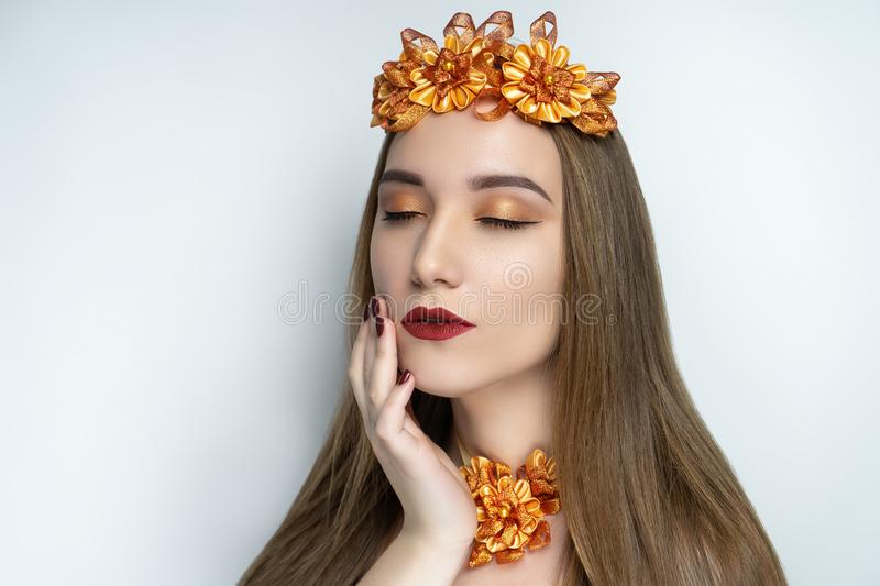 Young beautiful girl, massive gold accessory wreath stock images