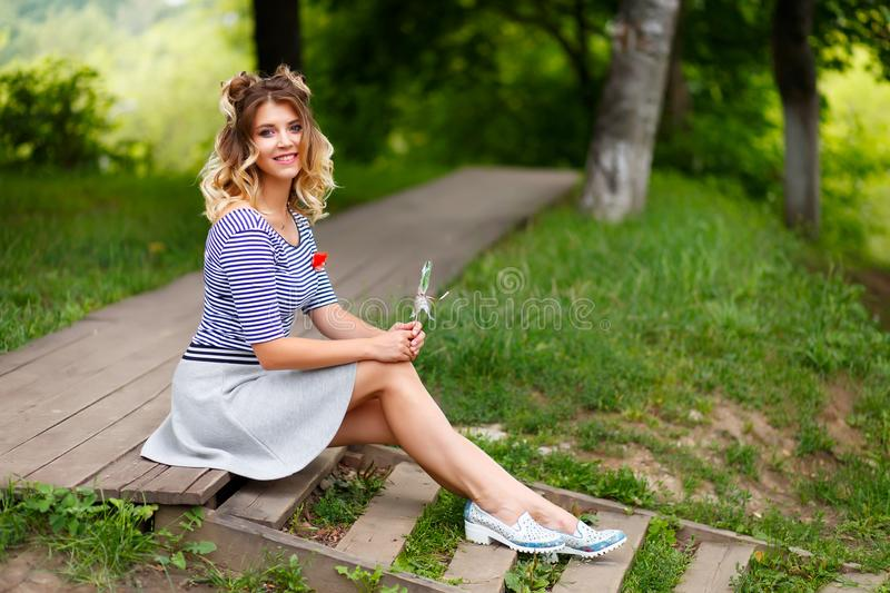 Young beautiful girl in the Park stock photo