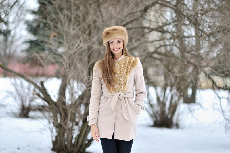 Young beautiful girl portrait in winter - outdoor. S royalty free stock photography
