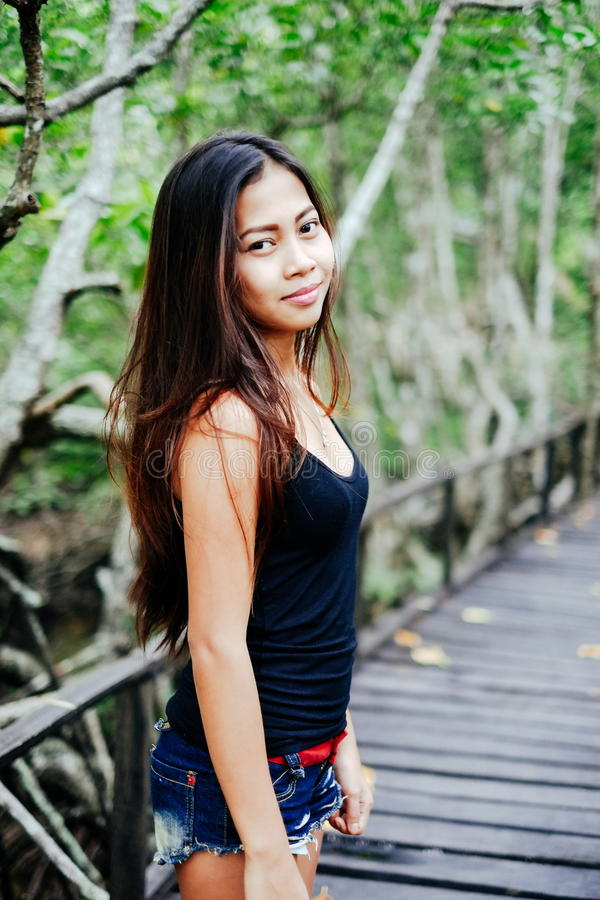 Young beautiful girl portrait on the wooden bridge in the mangrove forest.  royalty free stock images