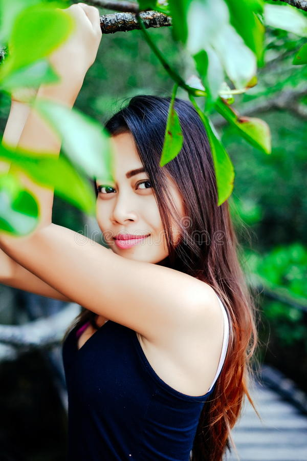 Young beautiful girl portrait on the wooden bridge in the mangrove forest.  stock photos
