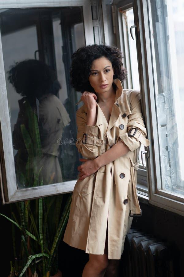Young beautiful girl posing  in studio royalty free stock image