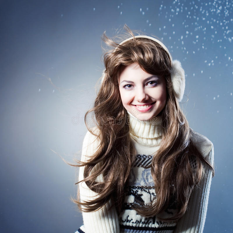Young beautiful girl rejoices to snow