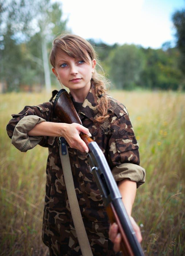 Young beautiful girl with a shotgun stock image