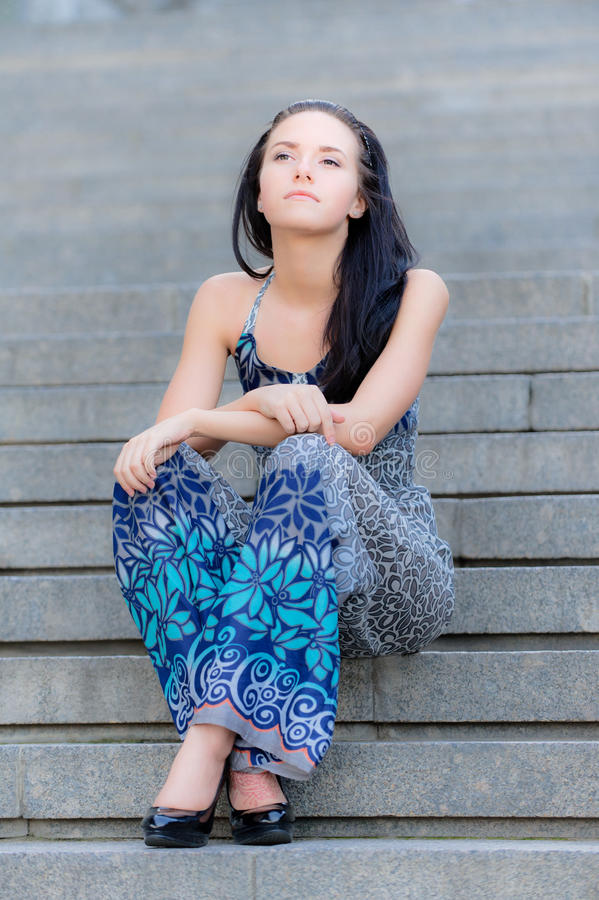 Download Young Beautiful Girl Sits On Steps Stock Photo - Image of closeup, female: 14572240