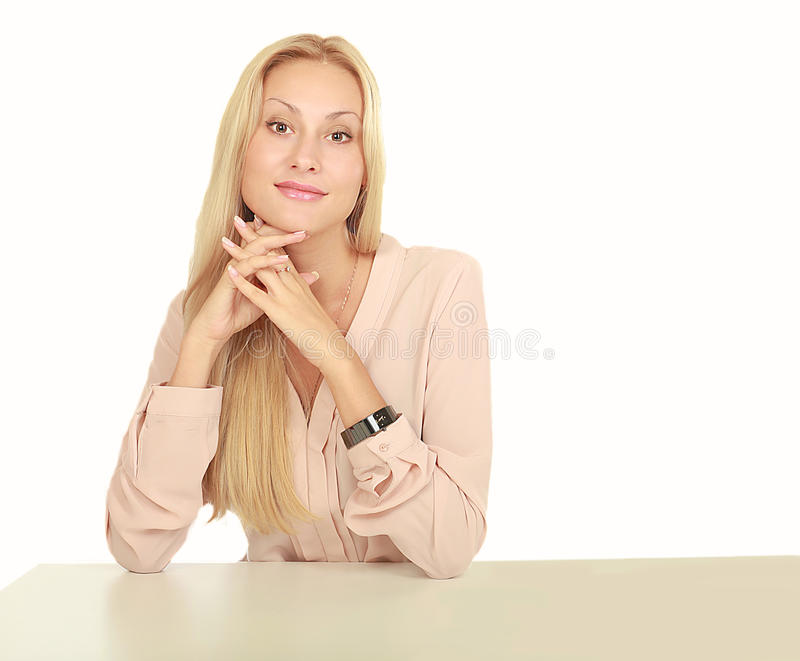Young beautiful girl sitting at the table.  royalty free stock photo
