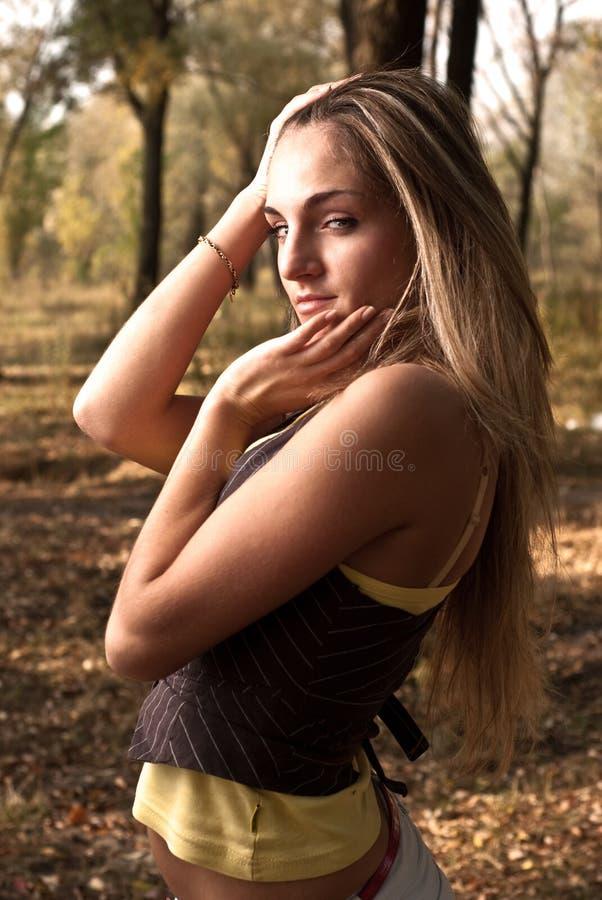 Young beautiful girl smiles stock photo
